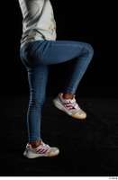 Elissa  1 blue jeans casual dressed flexing leg side view white sneakers 0004.jpg