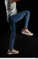 Elissa  1 blue jeans casual dressed flexing leg side view white sneakers 0005.jpg