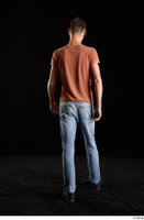 Alessandro Katz  1 back view black shoes blue jeans brown t shirt casual dressed walking whole body 0001.jpg
