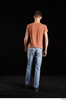 Alessandro Katz  1 back view black shoes blue jeans brown t shirt casual dressed walking whole body 0003.jpg