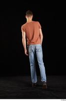 Alessandro Katz  1 back view black shoes blue jeans brown t shirt casual dressed walking whole body 0006.jpg