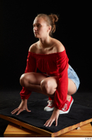 Stacy Cruz  1 blue jeans shorts casual dressed kneeling red off shoulder top red sneakers whole body 0002.jpg