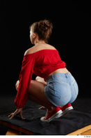 Stacy Cruz  1 blue jeans shorts casual dressed kneeling red off shoulder top red sneakers whole body 0004.jpg