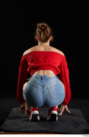 Stacy Cruz  1 blue jeans shorts casual dressed kneeling red off shoulder top red sneakers whole body 0005.jpg