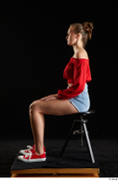 Stacy Cruz  1 blue jeans shorts casual dressed red off shoulder top red sneakers sitting whole body 0001.jpg