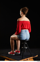 Stacy Cruz  1 blue jeans shorts casual dressed red off shoulder top red sneakers sitting whole body 0002.jpg