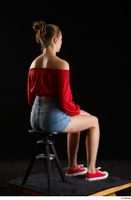 Stacy Cruz  1 blue jeans shorts casual dressed red off shoulder top red sneakers sitting whole body 0004.jpg