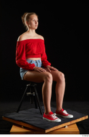 Stacy Cruz  1 blue jeans shorts casual dressed red off shoulder top red sneakers sitting whole body 0006.jpg