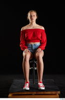 Stacy Cruz  1 blue jeans shorts casual dressed red off shoulder top red sneakers sitting whole body 0007.jpg
