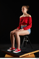 Stacy Cruz  1 blue jeans shorts casual dressed red off shoulder top red sneakers sitting whole body 0008.jpg