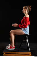 Stacy Cruz  1 blue jeans shorts casual dressed red off shoulder top red sneakers sitting whole body 0009.jpg