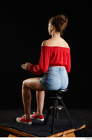 Stacy Cruz  1 blue jeans shorts casual dressed red off shoulder top red sneakers sitting whole body 0010.jpg