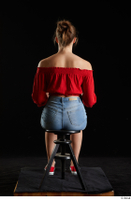 Stacy Cruz  1 blue jeans shorts casual dressed red off shoulder top red sneakers sitting whole body 0011.jpg