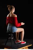 Stacy Cruz  1 blue jeans shorts casual dressed red off shoulder top red sneakers sitting whole body 0012.jpg