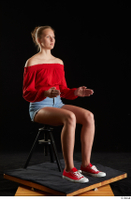 Stacy Cruz  1 blue jeans shorts casual dressed red off shoulder top red sneakers sitting whole body 0014.jpg