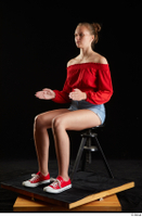 Stacy Cruz  1 blue jeans shorts casual dressed red off shoulder top red sneakers sitting whole body 0016.jpg
