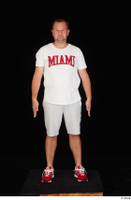 Louis dressed grey shorts red sneakers sports standing white t shirt whole body 0001.jpg