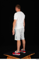 Louis dressed grey shorts red sneakers sports standing white t shirt whole body 0004.jpg