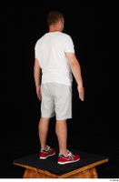 Louis dressed grey shorts red sneakers sports standing white t shirt whole body 0006.jpg