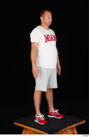 Louis dressed grey shorts red sneakers sports standing white t shirt whole body 0008.jpg