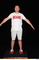 Louis dressed grey shorts red sneakers sports standing white t shirt whole body 0009.jpg