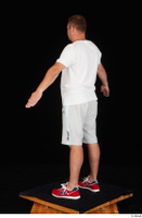 Louis dressed grey shorts red sneakers sports standing white t shirt whole body 0012.jpg