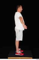 Louis dressed grey shorts red sneakers sports standing white t shirt whole body 0015.jpg