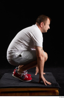 Louis  2 dressed grey shorts kneeling red sneakers sports white t shirt whole body 0007.jpg