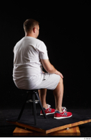 Louis  2 dressed grey shorts red sneakers sitting sports white t shirt whole body 0004.jpg