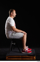 Louis  2 dressed grey shorts red sneakers sitting sports white t shirt whole body 0005.jpg