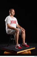 Louis  2 dressed grey shorts red sneakers sitting sports white t shirt whole body 0006.jpg