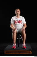 Louis  2 dressed grey shorts red sneakers sitting sports white t shirt whole body 0007.jpg