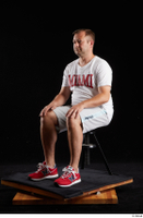 Louis  2 dressed grey shorts red sneakers sitting sports white t shirt whole body 0008.jpg