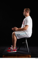 Louis  2 dressed grey shorts red sneakers sitting sports white t shirt whole body 0009.jpg
