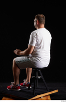 Louis  2 dressed grey shorts red sneakers sitting sports white t shirt whole body 0010.jpg