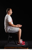 Louis  2 dressed grey shorts red sneakers sitting sports white t shirt whole body 0013.jpg