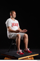 Louis  2 dressed grey shorts red sneakers sitting sports white t shirt whole body 0014.jpg