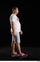 Louis  2 grey shorts red sneakers sports walking white t shirt whole body 0001.jpg