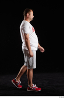 Louis  2 grey shorts red sneakers sports walking white t shirt whole body 0002.jpg