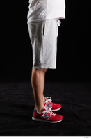 Louis  2 dressed flexing grey shorts leg red sneakers side view sports 0001.jpg