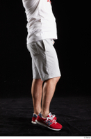 Louis  2 dressed flexing grey shorts leg red sneakers side view sports 0002.jpg