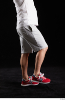 Louis  2 dressed flexing grey shorts leg red sneakers side view sports 0003.jpg