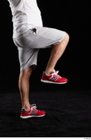 Louis  2 dressed flexing grey shorts leg red sneakers side view sports 0004.jpg