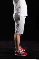 Louis  2 calf dressed flexing grey shorts red sneakers side view sports 0001.jpg