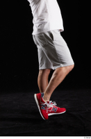 Louis  2 calf dressed flexing grey shorts red sneakers side view sports 0002.jpg