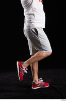 Louis  2 calf dressed flexing grey shorts red sneakers side view sports 0003.jpg