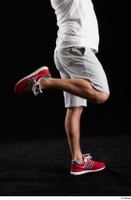 Louis  2 calf dressed flexing grey shorts red sneakers side view sports 0005.jpg