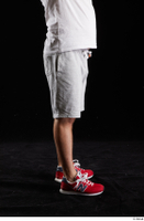 Louis  2 dressed flexing grey shorts leg red sneakers side view sports 0006.jpg