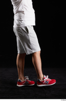 Louis  2 dressed flexing grey shorts leg red sneakers side view sports 0007.jpg