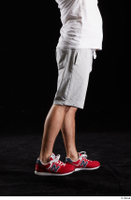 Louis  2 dressed flexing grey shorts leg red sneakers side view sports 0008.jpg